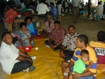 Locals at a Market, offering Kava to me.