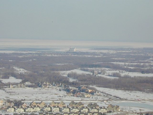 A grain elevator way in the distance